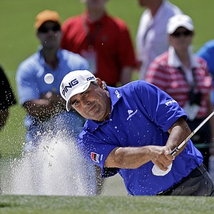 Angel Cabrera, of Argentina, hits out of a bunker on the second green during the third round.