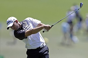 Sergio Garcia, of Spain, hits off the first fairway during the third round of the Masters.
