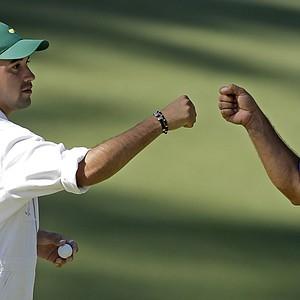 Angel Cabrera, of Argentina, fist pumps his caddie son Angel Cabrera, Jr. after a birdie on the 10th hole.