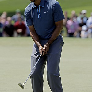Tiger Woods reacts after missing a birdie putt on the second green during the third round.