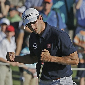 Adam Scott, of Australia, celebrates after a birdie on the 17th hole.