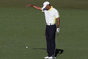 Tiger Woods drops on No. 15 at Augusta National during the second round of the 2013 Masters. A day later, he was assessed a two-stroke penalty for an improper drop.
