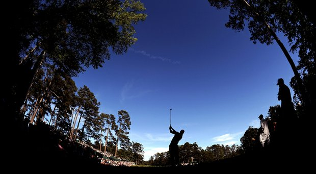 Tiger Woods hits his tee shot on the 14th hole during the third round of the 2013 Masters.
