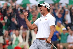 Adam Scott celebrates a birdie putt at No. 18 during the final round of the Masters.