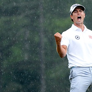 Adam Scott celebrates a birdie on No. 18 during the final round of the Masters.