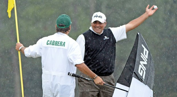 Angel Cabrera celebrates a birdie putt at No. 18 during the final round of the Masters.