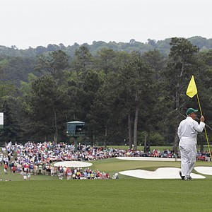Ball markers overlook the front nine during the fourth round of the Masters golf tournament.