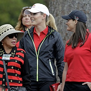 Tiger Woods' mother Kultida Woods, left, skier Lindsey Vonn and her physical therapist Lindsay Winninger, right, watch Woods during the fourth round of the Masters.