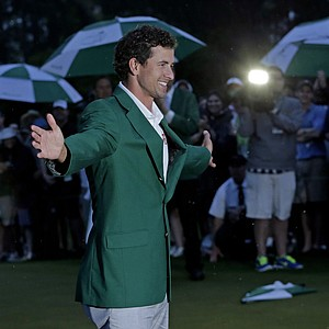 Adam Scott, of Australia, celebrates with his  green jacket after winning the Masters golf tournament.