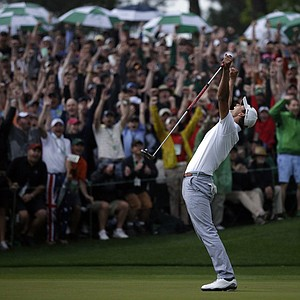 Adam Scott, of Australia, celebrates after making a birdie putt on the second playoff hole to win the Masters.