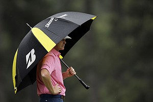 Brandt Snedeker peers from under his umbrella on the third hole during the fourth round.