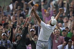 Adam Scott celebrates his winning birdie putt on the second playoff hole of the 2013 Masters.