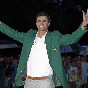 Adam Scott, of Australia, celebrates with his green jacket after winning the Masters golf tournament on Sunday.
