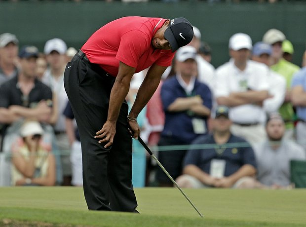 Tiger Woods reacts after missing a birdie putt on the first hole during the fourth round.