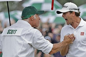 Adam Scott and caddie Steve Williams celebrate Scott's birdie at No. 18 during the final round of the Masters.