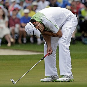 Jason Day, of Australia, reacts after missing a birdie putt on the 18th hole.