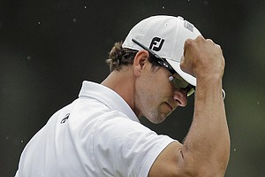 Adam Scott reacts after a birdie on the third green during the fourth round of the Masters.