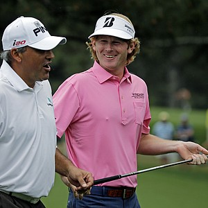 Brandt Snedeker, right, chats with Angel Cabrera, of Argentina, as they walk down the second fairway during the fourth round.