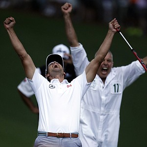Adam Scott, of Australia, celebrates with caddie Steve Williams after making a birdie putt on the second playoff hole to win the Masters.