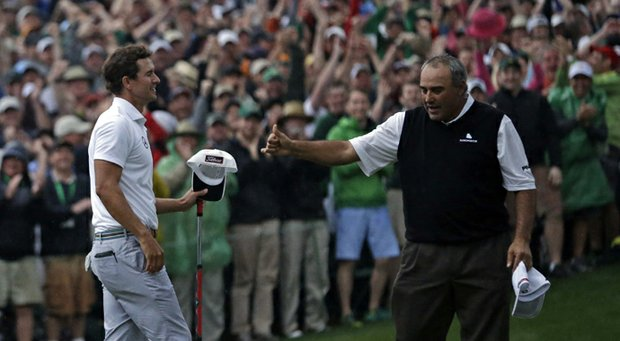 Adam Scott receives a thumbs-up from Angel Cabrera after sinking a birdie putt to win the 2013 Masters.
