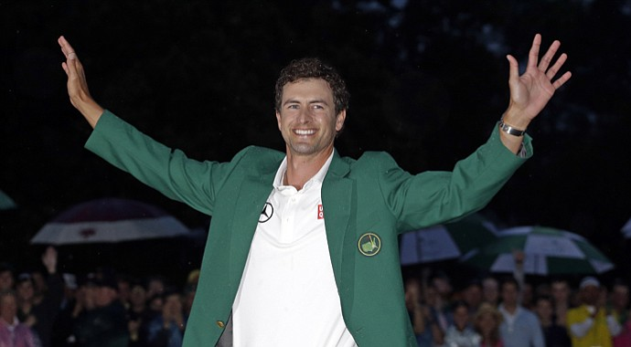 Adam Scott wears the green jacket after his 2013 Masters win in a playoff.