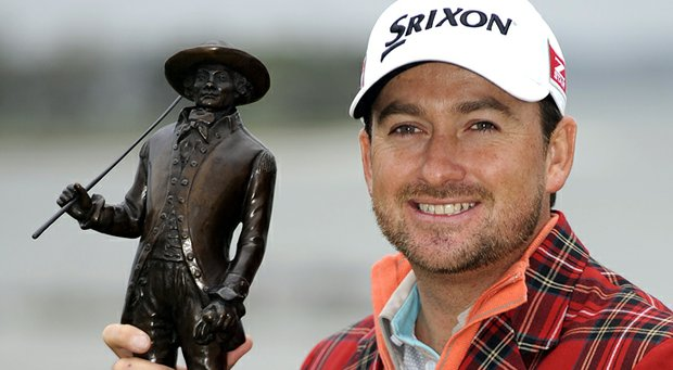 Graeme McDowell poses with the trophy after winning the RBC Heritage.
