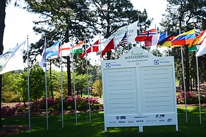 Flags representing countries of each of the players at the Junior Invitational fly over a scoreboard just in front of the clubhouse at Sage Valley.
