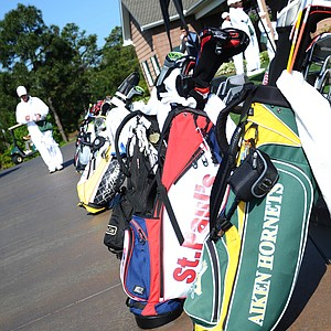 A plethora of bags are lined up behind the driving range at Sage Valley as the junior-am gets underway on Wednesday morning.