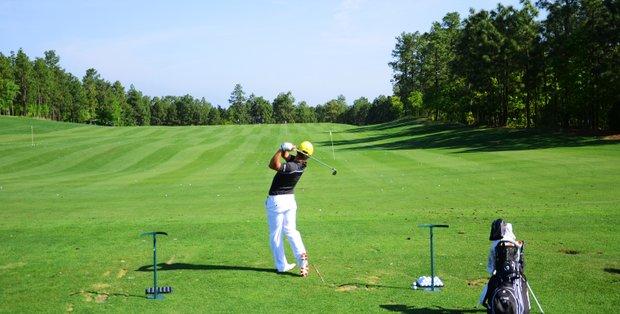 Ki Taek Lee, of La Quinta, Calif., hits on the range Wednesday morning at the Junior Invitational.