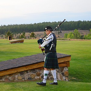 A bagpipe player rehearses prior to the start of the Opening Night at the Junior Invitational at Sage Valley.
