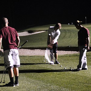 Arizona State commit Nicolo Galletti hits chip shots with a bunch of his Junior Invitational buddies during a round of night golf on Wednesday.