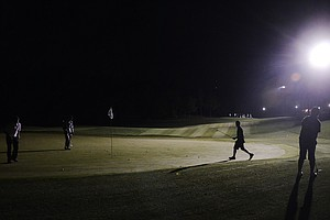 The par-3 green during a round of night golf at the Junior Invitational on Wednesday.
