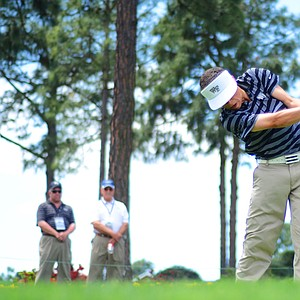 Danny Guise, of Greenwich, Conn., hits off the first tee during the junior-am on Thursday at the Junior Invitational at Sage Valley.
