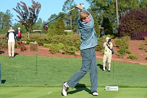 First Tee member Trenton Fuchs hits a ceremonial opening tee shot at the Junior Invitational on Friday.