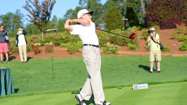 First Tee member Brycen Bessey hits a ceremonial opening tee shot at the Junior Invitational on Friday.