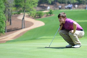Matthew Fitzpatrick lines up a putt on the 18th green during the first round of the Junior Invitational on Friday.