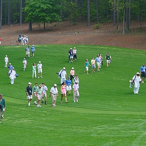 Throngs of fans follow local favorite Greyson Sigg during the second round of the Junior Invitational at Sage Valley.