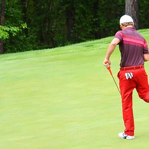 Sam Horsfield, who shot a 1-under 71 to take a two-shot lead into the final round, celebrates his birdie on the par-4 14th hole at Sage Valley on Saturday.