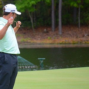 Austin Langdale reacts to a missed birdie putt on the par-4 17th hole at the Junior Invitational on Sunday.