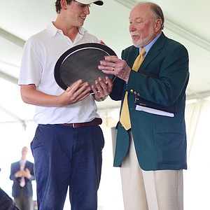 Michael Pisciotta receives the first Paul S. Simon award -- celebrating great character -- from Paul S. Simon on Sunday during Junior Invitational Closing Ceremonies.
