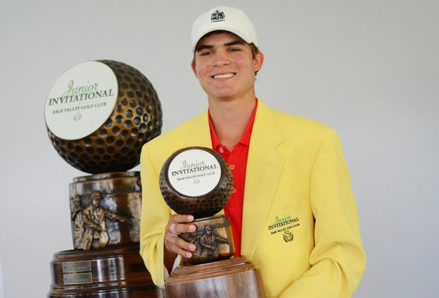 Carson Young dons the yellow jacket and holds the trophy after winning the Junior Invitational at Sage Valley on Sunday.