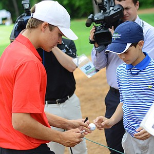 Carson Young signs autographs at the back of the 18th green after winning the Junior Invitational at Sage Valley.