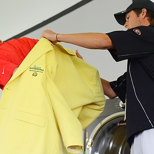 2011 champion Nicholas Reach (right) puts the Junior Invitational yellow jacket on 2013 winner Carson Young during the closing ceremonies on Sunday.