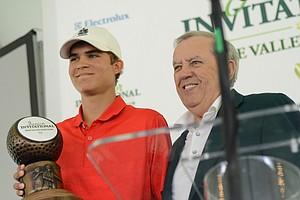 Carson Young (left) and Sage Valley owner Weldon Wyatt stop for photographers after Young received the Junior Invitational trophy on Sunday.