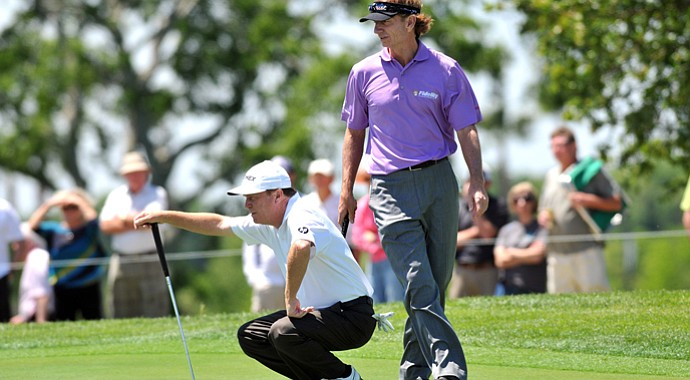 Jeff Sluman (left) reads a putt with an assist from Brad Faxon during the final round of the 2013 Liberty Mutual Legends of Golf, which they won.