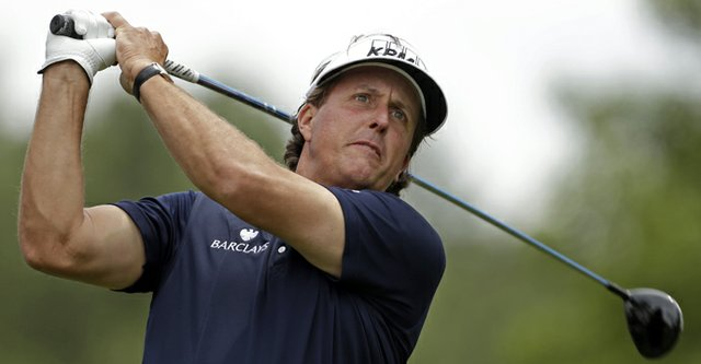 Phil Mickelson watches his tee shot on the fourth hole during the second round of the Wells Fargo Championship at Quail Hollow Club.