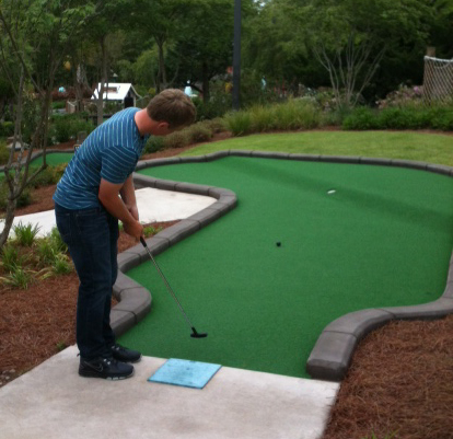 Brad Dalke plays mini golf at Frankie's Fun Park in Columbia, S.C., after finishing 16th at the Junior Invitational at Sage Valley. He found the greens a little easier than Sage Valley's.