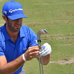 Dustin Johnson was given a new set of TaylorMade Forged Tour Preferred MB irons on Tuesday. He closely inspected the clubs and hit several of them to ensure they are exactly like the set he already had in his bag.