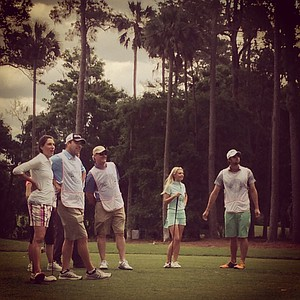 Olympic swimmer Michael Phelps, far right, and Golf Channel's Win McMurry watch along with Aaron and Angie Oberholser, far left, and Jim Thompson of Great Clips during the PGA Tour Wives Golf Classic.