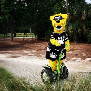 Jaxson de Ville of the Jacksonville Jaguars rides his Segway around during the PGA Tour Wives Golf Classic on Dye's Valley Course at TPC Sawgrass.